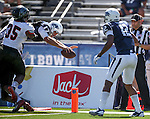 Nevada's quarterback Cody Fajardo (17) dives into the end zone against Southern Utah defender Chinedu Ahanonu (35) in the second half of an NCAA college football game on Saturday, Aug. 30, 2014 in Reno, Nev. Nevada's Hassan Henderson (12) is at right. (AP Photo/Cathleen Allison)