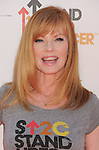 LOS ANGELES, CA - SEPTEMBER 07: Marg Helgenberger  arrives at Stand Up To Cancer at The Shrine Auditorium on September 7, 2012 in Los Angeles, California.