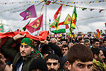 Spectators and participants stand in the crowd at Newroz, the Kurdish New Year celebration, in Diyarbakir, Turkey, March 21, 2015. Newroz, or Nowruz, is an ancient holiday celebrated by a multitude of ethnic groups across Iran, Central Asia, and the Caucuses, and ushers in the first day of Spring, March 21. For Kurds, Newroz is a means of political and cultural expression, featuring Kurdish politicians, activists, and musicians, and has become a manifestation of Kurdish identity. In Turkey, the celebrations begin a few days before the Vernal Equinox, culminating in a huge gathering in the heart of Turkey's Kurdish population, the southeastern city of Diyarbakir. This year, PKK founder Abdullah Öcalan, who despite serving a life sentence for treason still enjoys widespread influence among Kurds, sent a letter that was read at Newroz in Diyarbakir, calling for an end to the PKK's armed struggle against the Turkish state.