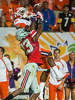 January 3, 2014 - Miami Gardens, Florida, U.S: Ohio State Buckeyes defensive back Tyvis Powell (23) breaks up a pass intended for Clemson Tigers wide receiver Mike Williams (7) during second half action of the Discover Orange Bowl between the Clemson Tigers and the Ohio State Buckeyes. Clemson defeated Ohio State 40-35 at Sun Life Stadium in Miami Gardens, Fl