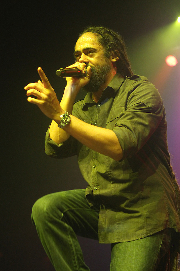 "Damian Marley performs during the ""Catch A Fire Tour 2015"" stop at The Paramount in Huntington, Long Island on Tuesday, Sept. 1, 2015, in New York. (Photo by Donald Traill/Invision/AP)"