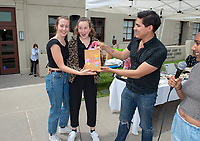 Second place winners Salad Fingers<br /> Six student teams battle to win the Iron Chef competition as part of Earth Month on Thursday, April 11, 2019 in the JSC Quad. Event MC, Amos Himmelstein, provided play-by-play of the action. Their task was to create the best vegetarian or vegan starter and sauté dishes. A wide variety of fresh organic produce (some freshly picked at the FEAST garden), FEAST eggs, spices, oils AND one secret ingredient were at the team's disposal.<br /> Chef Brad Kent, owner of Olio GCM Wood Fired Pizzeria at Grand Central Market and co-Founder/chief culinary officer for Blaze Pizza, is this year's guest judge.<br /> The contest is led by FEAST and supported by Campus Dining, Facilities Management, RESF, and the Office of the President.<br /> (Photo by Marc Campos, Occidental College Photographer)