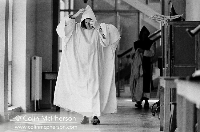 A monk makes his way to the prayer chapel at Sancta Maria Abbey at Nunraw, East Lothian, home since 1946 to the Order of Cistercians of the Strict Observance. Around 15 monks were resident at Nunraw in 1996, undertaking a mixture of daily tasks and strict religious observance. The present purpose-built building dates from 1969 when the monks moved from the nearby Nunraw house.