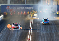 Feb 21, 2014; Chandler, AZ, USA; NHRA funny car driver Bob Tasca III (left) races alongside Jeff Diehl during qualifying for the Carquest Auto Parts Nationals at Wild Horse Pass Motorsports Park. Mandatory Credit: Mark J. Rebilas-USA TODAY Sports