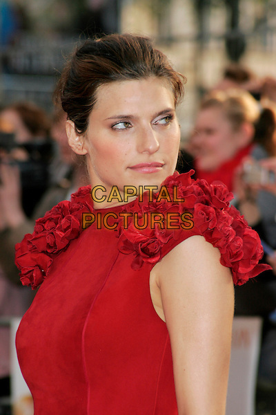"LAKE BELL.World premiere of ""What Happens In Vegas"" held at the Odeon Leicester Square, London, England..April 22nd 2008.headshot portrait red ruffles ruffled shoulders flowers looking over shoulder .CAP/AH.©Adam Houghton/Capital Pictures."