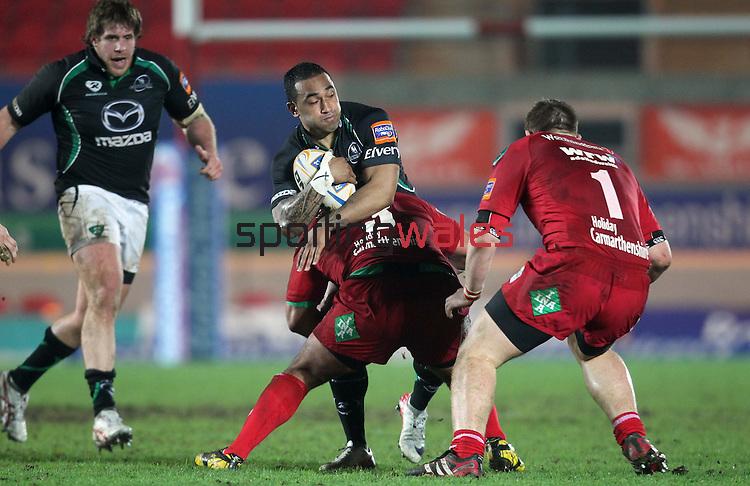 Deacon Manu stops Fetu'u Vainikolo in his tracks..RaboDirect Pro12.Scarlets v Connacht.02.03.12.©STEVE POPE