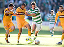 CELTIC'S GEORGIOS SAMARAS HOLDS OFF MOTHERWELL'S STEVEN JENNINGS  AND CHRIS HUMPHREY