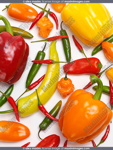 Variety of sweet and hot peppers, colorful food background. Red, yellow, orange sweet peppers, Jalapeno, Cubanelle, Thai peppers, Scotch Bonnet pepper, mini sweet peppers.