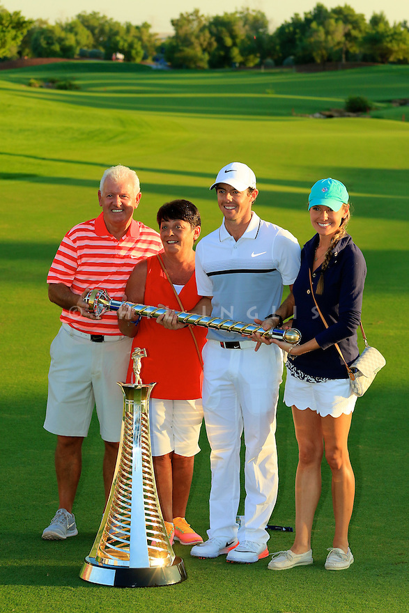 Rory McIlroy (IRE), girlfriend Erica Stoll and family with the trophy during the final round of the DP World Golf Championship played at the Earth Course, Jumeira Golf Estates, Dubai 19-22 November 2015. (Picture Credit / Phil Inglis )