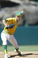 Mike Venafro of the Oakland Athletics pitches during a 2002 MLB season game against the Los Angeles Angels at Angel Stadium, in Anaheim, California. (Larry Goren/Four Seam Images)