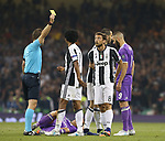 Claudio Marchisio of Juventus receives a yellow card  during the Champions League Final match at the Millennium Stadium, Cardiff. Picture date: June 3rd, 2017.Picture credit should read: David Klein/Sportimage