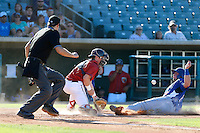 Tyler Heineman #26 of the Lancaster JetHawks waits for the ball as Pratt Maynard #18 of the Rancho Cucamonga Quakes slides into home plate during a game at The Hanger on August 25, 2013 in Lancaster, California. Lancaster defeated Rancho Cucamonga, 7-1. (Larry Goren/Four Seam Images)
