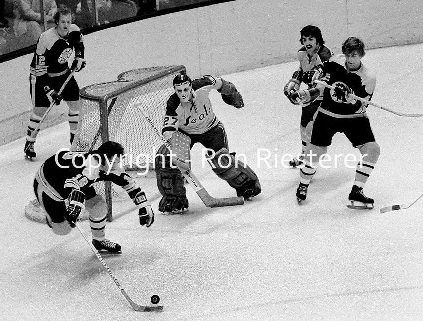 California Golden Seals vs. Boston Bruins..Derek Sanderson. #12 Wayne Cashman, and #4 Bobby Orr, against the Seals Carol Vadnais and goalie Gilles Meloche..(1972 photo/Ron Riesterer)