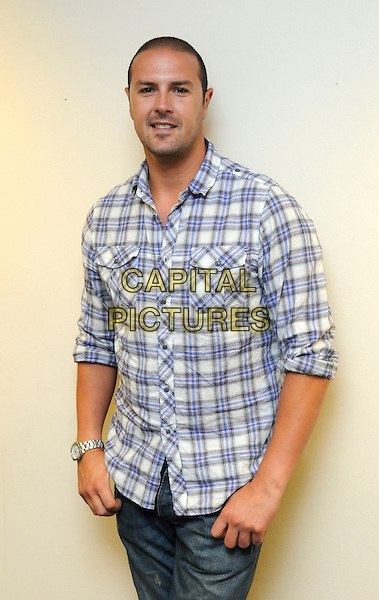 PADDY McGUINNESS.In North West London, England..July 14th, 2009.half length blue white check checked shirt.CAP/FIN.©Steve Finn/Capital Pictures.