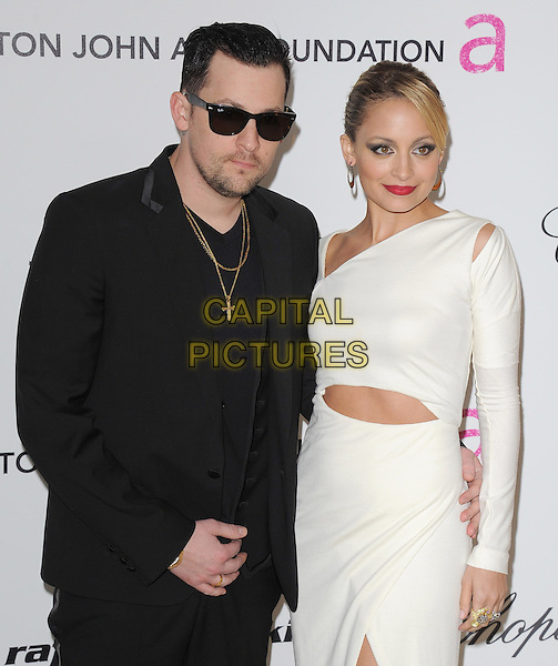JOEL MADDEN & NICOLE RICHIE MADDEN.19th Annual Elton John AIDS Foundation Academy Awards Viewing Party held at The Pacific Design Center, West Hollywood, California, USA..February 27th, 2011.half length white dress slit split long sleeves slash slashed cut out away sunglasses shades black suit jacket married husband wife .CAP/RKE/DVS.©DVS/RockinExposures/Capital Pictures.