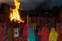 The night before the Holi festival in Jaipur, huge Bon Fires are lit up through out the city and the first color powder is been dished out.