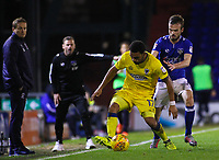 AFC Wimbledon's Andy Barcham shields the ball from Oldham Athletic's Cameron Dummigan  during the Sky Bet League 1 match between Oldham Athletic and AFC Wimbledon at Boundary Park, Oldham, England on 21 November 2017. Photo by Juel Miah/PRiME Media Images