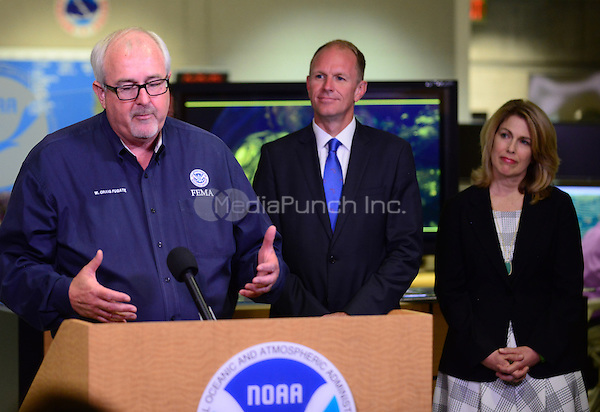 MIAMI, FL - JUNE 01: Craig Fugate, administrator, Federal Emergency Management Agency, Bryan Koon, director, State of Florida Emergency Management and  Leslie Chapman-Henderson, CEO, Federal Alliance for Safe Homes (FLASH) attend the start of hurricane season news conference at NOAA's National Hurricane Center on June 01, 2015 in Miami Beach, Florida. Credit: MPI10 / MediaPunch