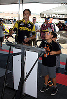 Jul. 26, 2013; Sonoma, CA, USA: A young races fan challenges NHRA top fuel dragster driver Morgan Lucas on the practice tree in the Toyota display during qualifying for the Sonoma Nationals at Sonoma Raceway. Mandatory Credit: Mark J. Rebilas-