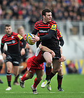 Duncan Taylor is tackled in possession. Aviva Premiership match, between Saracens and London Welsh on March 3, 2013 at Allianz Park in London, England. Photo by: Patrick Khachfe / Onside Images