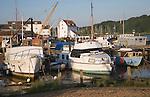 Boats at moorings at low tide, River Deben, Woodbridge, Suffolk, England
