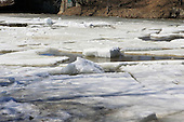 ice breaking up on river in spring in Joliette,Quebec