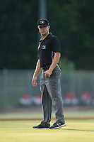 Umpire Aaron Schorch handles the calls on the bases during the South Atlantic League game between the West Virginia Power and the Kannapolis Intimidators at Kannapolis Intimidators Stadium on July 19, 2017 in Kannapolis, North Carolina.  The Power defeated the Intimidators 7-4 in 11 innings.  (Brian Westerholt/Four Seam Images)