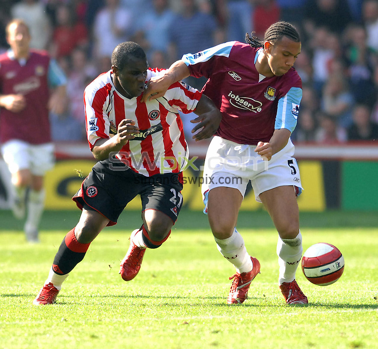 Pix: Howard Roe/swpix.com. Football, Barclays Premier League, Sheffield United  v West Ham, 14/04/07. 3.00pm KO..copyright picture>>simon wilkinson>>07811267706>>...West Ham's Anton Ferdinard shields the ball from Sheffield's Christain Nade
