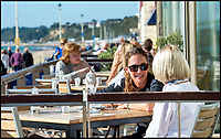 BNPS.co.uk (01202 558833)<br /> Pic: RogerArbon/BNPS<br /> <br /> It's red hot October!<br /> <br /> Unseasonably warm weather draws people to Bournemouth beach to soak up the last of the summer rays.