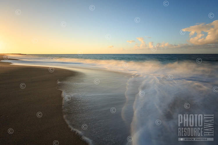 A long exposure of the surf and sand at sunset at Lumaha'i Beach, Kaua'i.