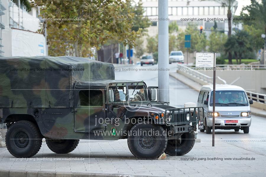 LEBANON, Beirut, military patrol in front of Holiday Inn Hotel , american Humvee van / LIBANON, Beirut, Militaerfahrzeug der libanesischen Armee vor im Krieg zerstoerten Holiday Inn Hotel