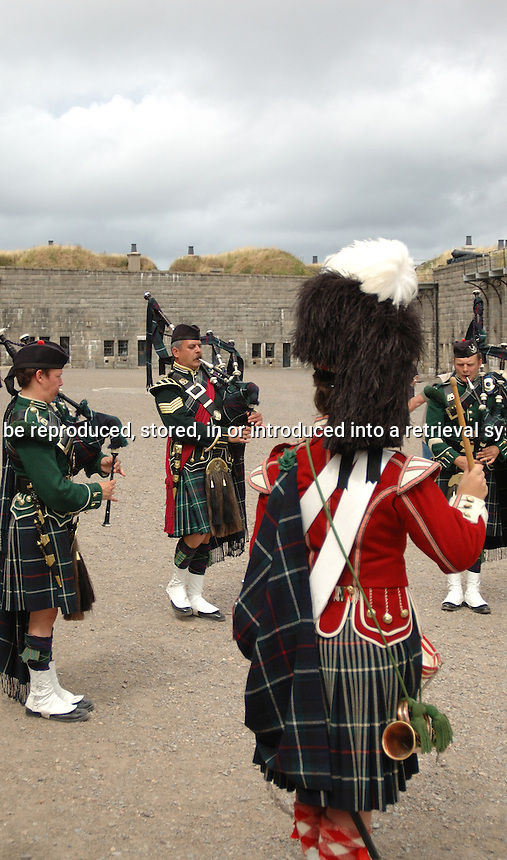 Bag Piper playing the bag pipes in period costume Citadel Hill Halifax Nova Scotia
