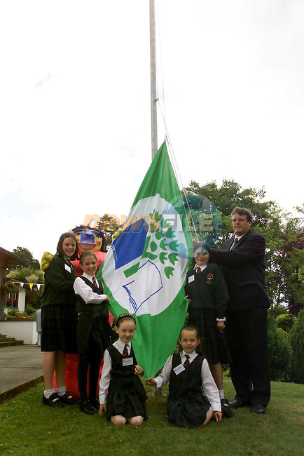 Scoil Mhuire na Tricaire in Ardee with there Green Flag with the Auntie Litter Bug and Cllr Finan McCoy and students Una Coleman, Georgia Baylon-Matthews, Jacinta Devins, Nichola Grau and Aisling Carroll..Picture Fran Caffrey Newsfile
