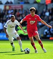 Pictured: (L-R) Swansea's Jonathan De Guzman chasing Jack Cork of Southampton.<br /> Saturday 20 April 2013<br /> Re: Barclay's Premier League, Swansea City FC v Southampton at the Liberty Stadium, south Wales.
