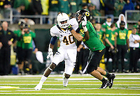 October 6th, 2011:  Chris McCain of California tries to beat David Paulson of Oregon during a game at Autzen Stadium in Eugene, Oregon - Oregon defeated Cal 43 - 15
