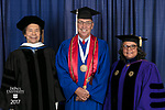Left to right, commencement speaker and honorary degree recipient Stuart Dybek, poet and fiction writer, Jerry T. Lange, student speaker, Marisa Alicea, dean of the School for New Learning. DePaul University School for New Learning held its commencement ceremony, Saturday, June 10, 2017, at the Rosemont Theatre in Rosemont, IL. The Rev. Dennis H. Holtschneider, C.M., president of DePaul, conferred the degrees. (DePaul University/Jeff Carrion)
