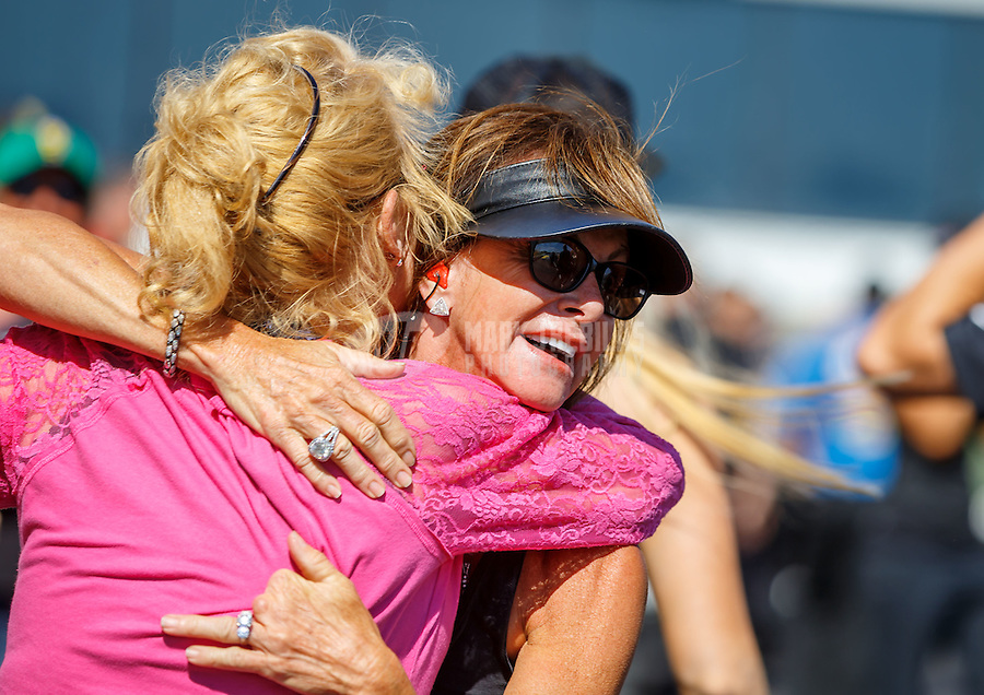 Jun 12, 2016; Englishtown, NJ, USA; Kay Torrence celebrates after NHRA top fuel driver Steve Torrence wins the Summernationals at Old Bridge Township Raceway Park. Mandatory Credit: Mark J. Rebilas-USA TODAY Sports