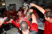 Pawtucket Red Sox hitting coach Gerald Perry is doused by his team including Dan Butler after game four of a best of five playoff series against the Empire State Yankees at Frontier Field on September 8, 2012 in Rochester, New York.  Pawtucket defeated Empire State 7-1 to advance to the International League Finals.  (Mike Janes/Four Seam Images)