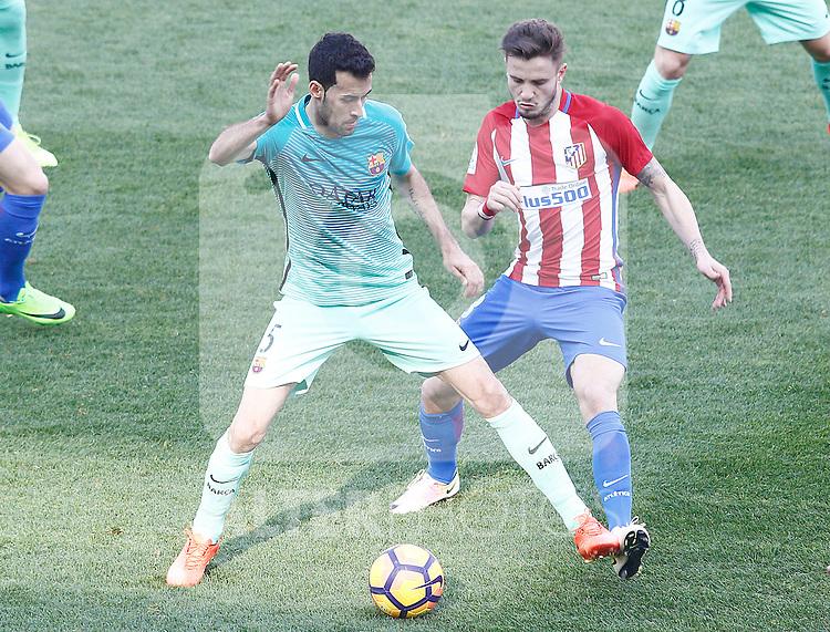 Atletico de Madrid's Saul Niguez (r) and FC Barcelona's Sergio Busquets during La Liga match. February 26,2017. (ALTERPHOTOS/Acero)