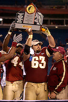 JACKSONVILLE, FL. 12/3/05-FSU players Sam McGrew, left, David Castillo and Coach Bobby Bowden celebrate winning the  ACC Championship Saturday at Alltel Stadium in Jacksonville. COLIN HACKLEY PHOTO