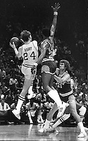 Warriors Rick Barry goes against Gar Heard and Dennis Autrey of the Phoenix Suns. (1976 photo by Ron Riesterer)