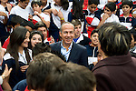 President Felipe Calderon greets students at a school in Morelia
