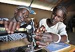 Besta Kide learns about sewing from Rehema Ajiba Asga, who teaches classes in a community center in Mugwo, in Southern Sudan. The skills training program is sponsored by the United Methodist Committee on Relief (UMCOR). NOTE: In July 2011, Southern Sudan became the independent country of South Sudan