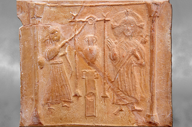 Detail of a 6th-7th Century Eastern Roman Byzantine  Christian Terracotta tiles depicting Christ changing Water into wine - Produced in Byzacena -  present day Tunisia. <br /> <br /> These early Christian terracotta tiles were mass produced thanks to moulds. Their quadrangular, square or rectangular shape as well as the standardised sizes in use in the different regions were determined by their architectonic function and were designed to facilitate their assembly according to various combinations to decorate large flat surfaces of walls or ceilings. <br /> <br /> Byzacena stood out for its use of biblical and hagiographic themes and a richer variety of animals, birds and roses. Some deer and lions were obviously inspired from Zeugitana prototypes attesting to the pre-existence of this province's production with respect to that of Byzacena. The rules governing this art are similar to those that applied to late Roman and Christian art with, in the case of Byzacena, an obvious popular connotation. Its distinguishing features are flatness, a predilection for symmetrical compositions, frontal and lateral representations, the absence of tridimensional attitudes and the naivety of some details (large eyes, pointed chins). Mass production enabled this type of decoration to be widely used at little cost and it played a role as ideograms and for teaching catechism through pictures. Painting, now often faded, enhanced motifs in relief or enriched them with additional details to break their repetitive monotony.<br /> <br /> The Bardo National Museum Tunis, Tunisia. Against a grey art background.