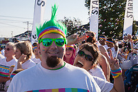 Man with green glasses and mohawk, The Color Run 2015, Tacoma, Washington State, WA, America, USA.