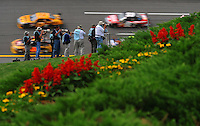 Apr 25, 2008; Talladega, AL, USA; Photographers shoot NASCAR Sprint Cup Series drivers as they race through turn four during practice for the Aarons 499 at Talladega Superspeedway. Mandatory Credit: Mark J. Rebilas-US PRESSWIRE