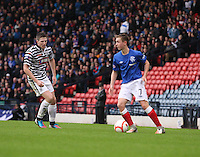 Robbie Crawford being closed down by Paul Gallacher in the Queen's Park v Rangers Irn-Bru Scottish League Division Three match played at Hampden Park, Glasgow on 29.12.12. .