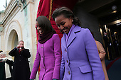 Malia Obama, left, and Sasha Obama, right, arrive during the presidential inauguration on the West Front of the U.S. Capitol January 21, 2013 in Washington, DC.   Barack Obama was re-elected for a second term as President of the United States.      .Credit: Win McNamee / Pool via CNP