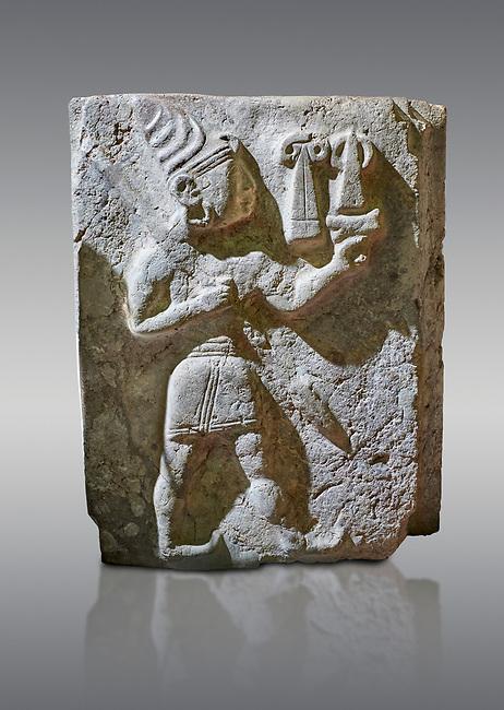 Hittite orthostat relief depicting a god. Hittie Period 1450 - 1200 BC. Hattusa Boğazkale. Hattusa Boğazkale. Çorum Archaeological Museum, Corum, Turkey. Çorum Archaeological Museum, Corum, Turkey