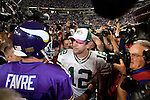 Minnesota Vikings quarterback Brett Favre (4) meets former teammate Green Bay Packers quarterback Aaron Rodgers (12) after an NFL football game at the Hubert H. Humphrey Metrodome on October 5, 2009 in Minneapolis, Minnesota. The Vikings won 30-23. (AP Photo/David Stluka)